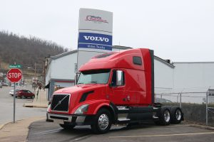 2011 Volvo VNL64T670 Red and Black